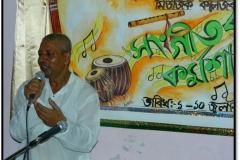 Gunin Ojha Borgeet performing Naukhelor Geet, 2013
