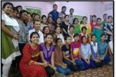 Guru Jna Rajkumari with our students after performing Jonojatiyo Geet, 2014